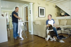 Kevin Pilla, 43, and his partner of 23 years Thomas Mannix, 44, with dog Buddy, prepare for their civil union ceremony that took place at midnight February 22, 2007 in Asbury Park, New Jersey. The couple was registered as a domestic partnership in 1993 in New York and 2004 in New Jersey. [Getty Images, via Andrew Sullivan]